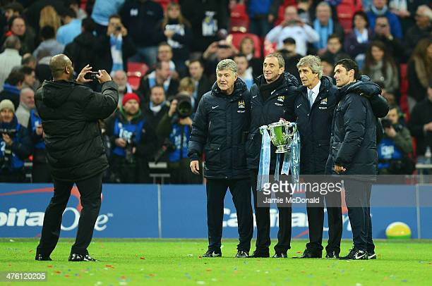 Manuel Pellegrini manager of Manchester City poses with support staff including assistant Brian Kidd after the Capital One Cup Final between...