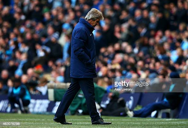 Manuel Pellegrini manager of Manchester City reacts during the FA Cup Fourth Round match between Manchester City and Middlesbrough at Etihad Stadium...