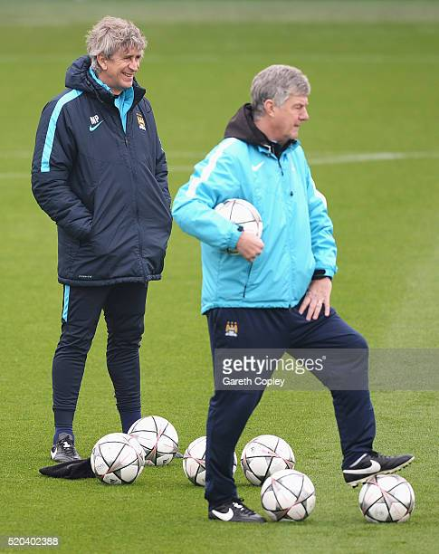 Manuel Pellegrini manager of Manchester City smiles with assistant Brian Kidd during a training session ahead of the UEFA Champions League Quarter...