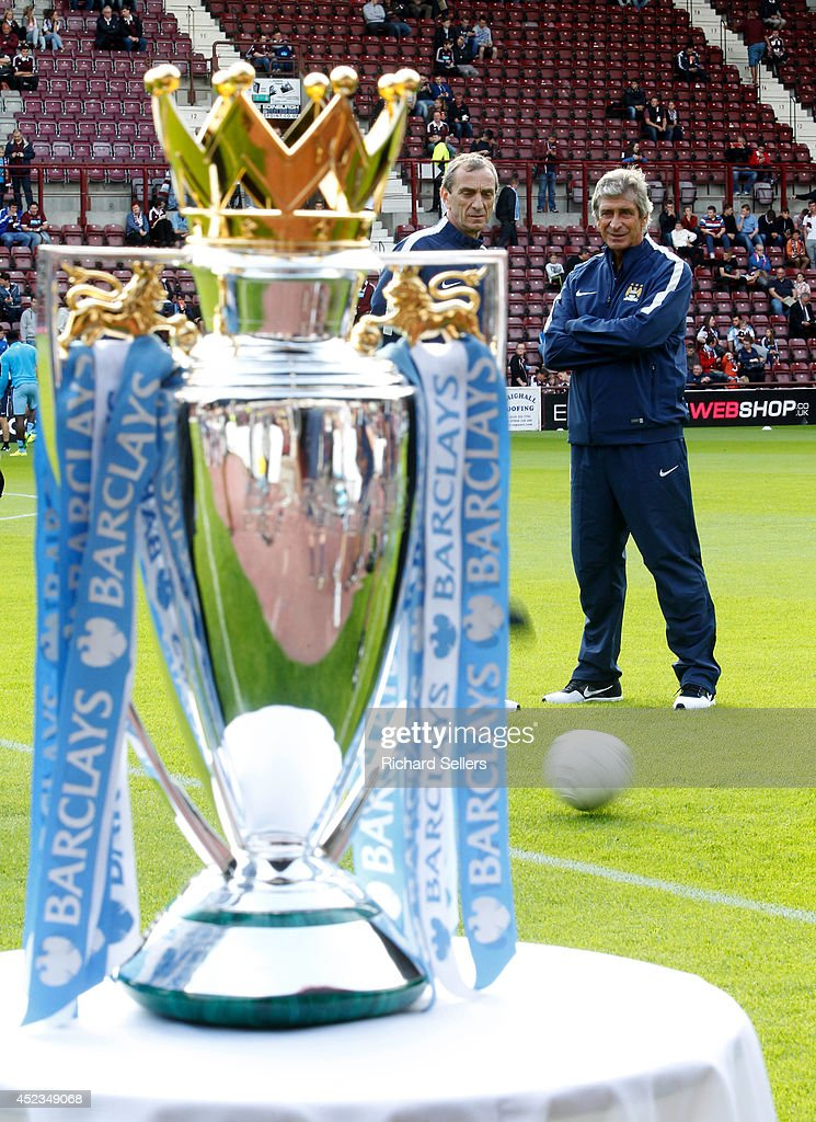 Manuel Pellegrini, manager of Manchester City stands behind the Barclays Premiership trophy before the pre-season friendly at Tynecastle Stadium on July 18, 2014 in Edinburgh, Scotland.