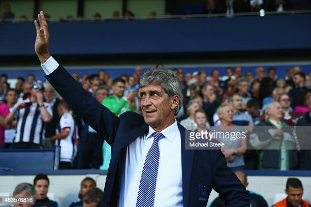 Manuel Pellegrini manager of Manchester City waves to the travelling fans prior to the Barclays Premier League match between West Bromwich Albion and...