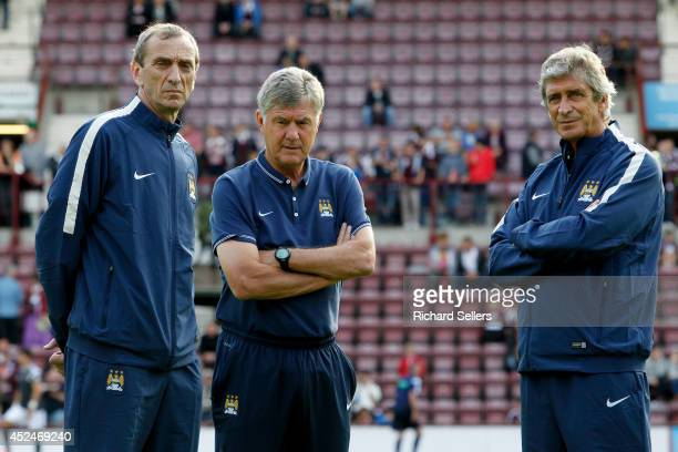 Manuel Pellegrini manager of Manchester City with assistant coach's Brian Kidd and Ruben Cousillas before the preseason friendly at Tynecastle...