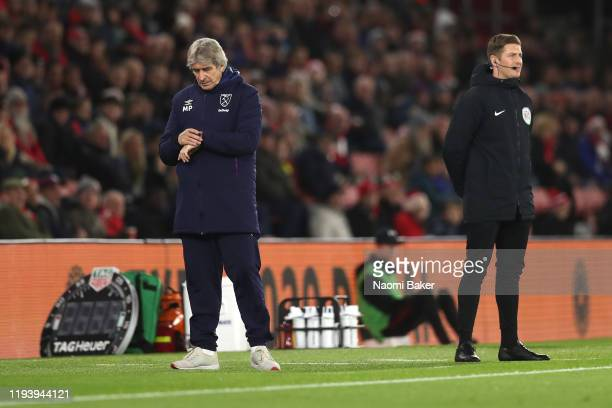 Manuel Pellegrini, Manager of West Ham United checks his watch during the Premier League match between Southampton FC and West Ham United at St...