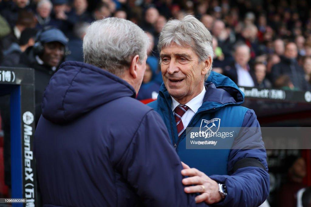 Manuel Pellegrini, Manager of West Ham United emrbraces Roy Hodgson,...