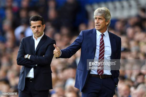 Manuel Pellegrini Manager of West Ham United gives his team instructions during the Premier League match between Everton FC and West Ham United at...