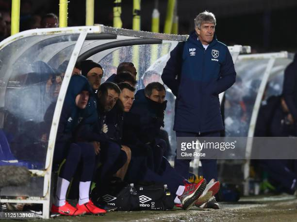 Manuel Pellegrini manager of West Ham United looks on during the FA Cup Fourth Round match between AFC Wimbledon and West Ham United at The Cherry...