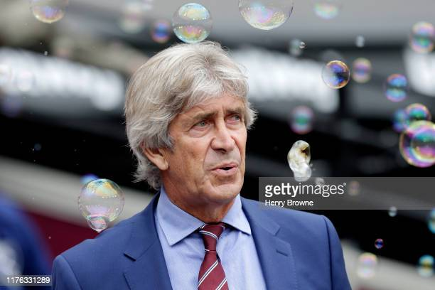 Manuel Pellegrini, Manager of West Ham United looks on prior to the Premier League match between West Ham United and Manchester United at London...