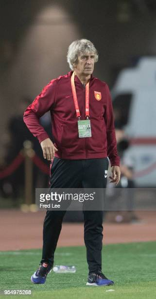 Manuel Pellegrini of Hebei China Fortune looks on piror to the 2018 Chinese Super League match between Hebei China Fortune adn Henan Jianye at...