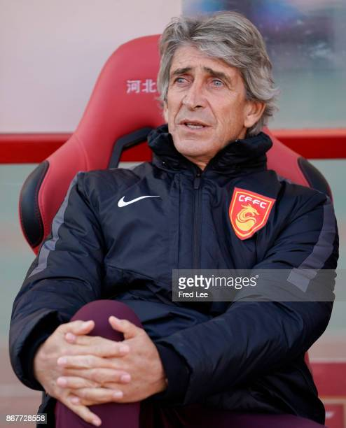 Manuel Pellegrini of Hebei China Fortune looks on piror to the Chinese Super League match between Hebei China Fortune and Guangzhou Evergrande at...