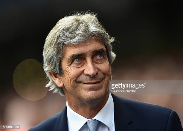 Manuel Pellegrini of Manchester City looks on during the Barclays Premier League match between Manchester City and Arsenal at the Etihad Stadium on...