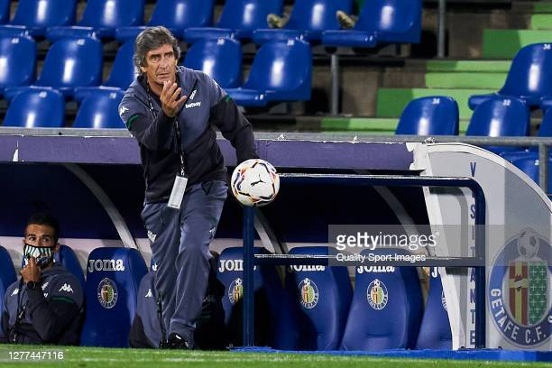 Manuel Pellegrini of Real Betis throws the ball back into the field during the La Liga Santander match between Getafe CF and Real Betis at Coliseum...