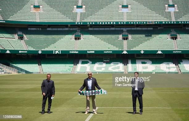 Manuel Pellegrini President Angel Haro and Sports director Alexis Trujillo pose during Manuel Pellegrini´s unveiling at Estadio Benito Villamarin on...
