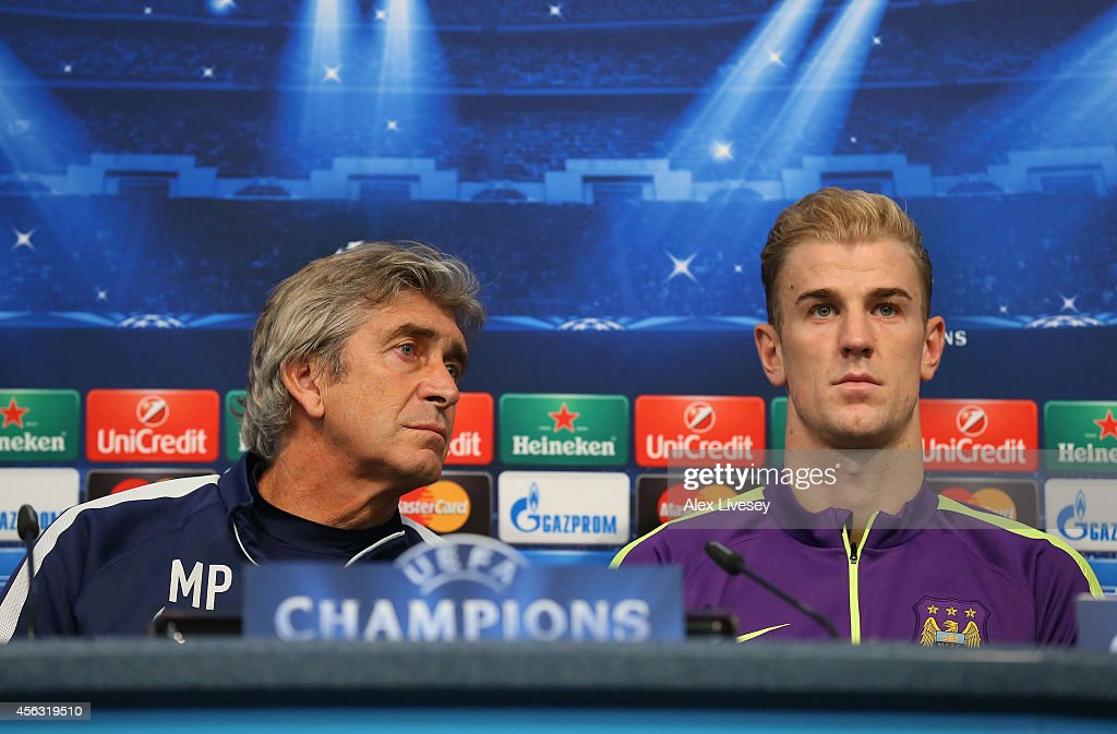 Manuel Pellegrini the manager of Manchester City and Joe Hart face the media during a press conference at the Etihad Stadium on September 29, 2014 in Manchester, England.