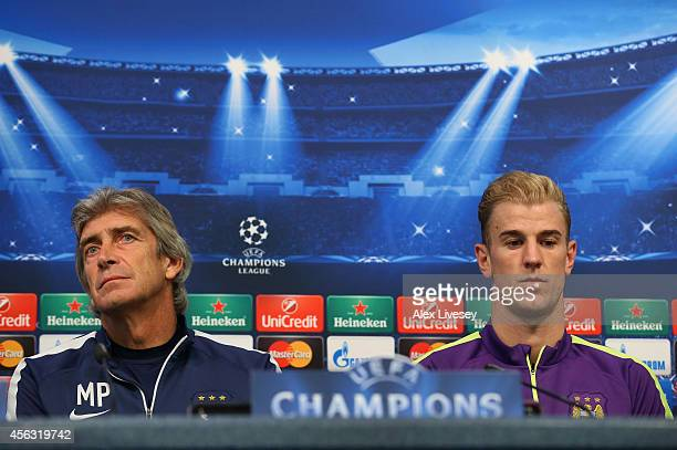 Manuel Pellegrini the manager of Manchester City and Joe Hart face the media during a press conference at the Etihad Stadium on September 29 2014 in...