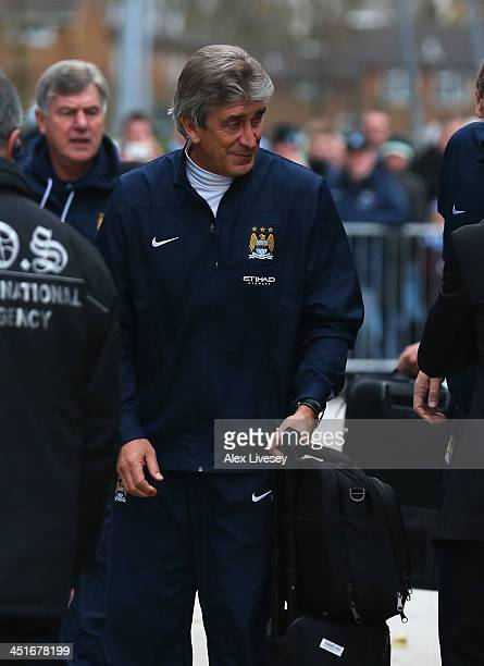 Manuel Pellegrini the manager of Manchester City arrives prior to the Barclays Premier League match between Manchester City and Tottenham Hotspur at...