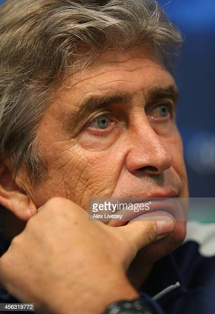 Manuel Pellegrini the manager of Manchester City faces the media during a press conference at the Etihad Stadium on September 29 2014 in Manchester...