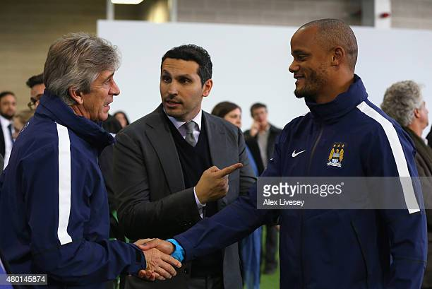 Manuel Pellegrini the manager of Manchester City Khaldoon Al Mubarek the Manchester City Chairman and Vincent Kompany the captain of Manchester City...