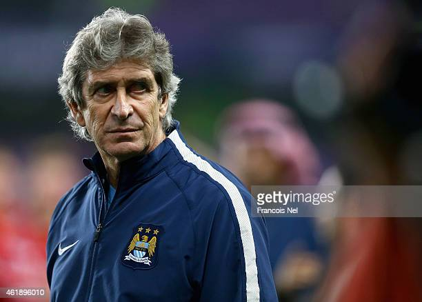 Manuel Pellegrini the manager of Manchester City looks on after the friendly match between Hamburg SV and Manchester City at Hazza bin Zayed Stadium...