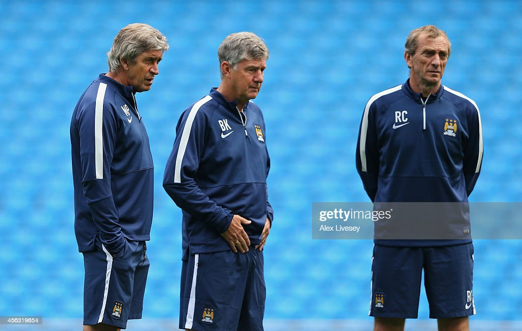 Manuel Pellegrini the manager of Manchester City looks on with his assistants, Brian Kidd and Ruben Cousillas, during a training session at the Etihad Stadium on September 29, 2014 in Manchester, England.