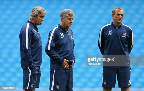 Manuel Pellegrini the manager of Manchester City looks on with his assistants Brian Kidd and Ruben Cousillas during a training session at the Etihad...