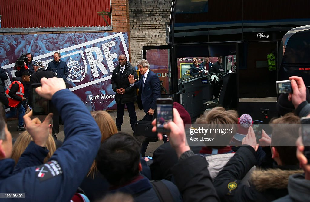 Manuel Pellegrini the manager of Manchester City waves to supporters as the team arrive at Turf Moor prior to the Barclays Premier League match between Burnley and Manchester City at Turf Moor on March 14, 2015 in Burnley, England.