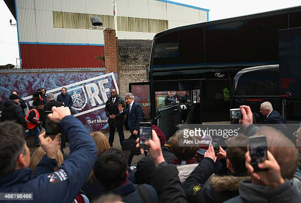 Manuel Pellegrini the manager of Manchester City waves to supporters as the team arrive at Turf Moor prior to the Barclays Premier League match...