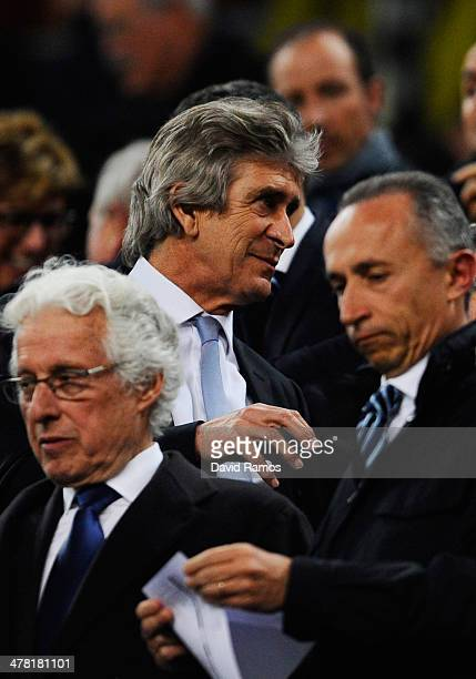 Manuel Pellegrini the Manchester manager watches from the stands due to a two match touchline ban during the UEFA Champions League Round of 16,...