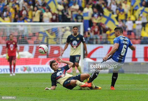Manuel Perez of America vies for the ball with Javier Guemez of Queretaro during their Mexican Apertura Tournament 2017 football match at the Azteca...
