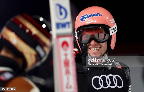 Manuel Poppinger of Austria reacts after his competetion jump of the FIS Nordic World Cup Four Hills Tournament on January 6 2018 in Bischofshofen...