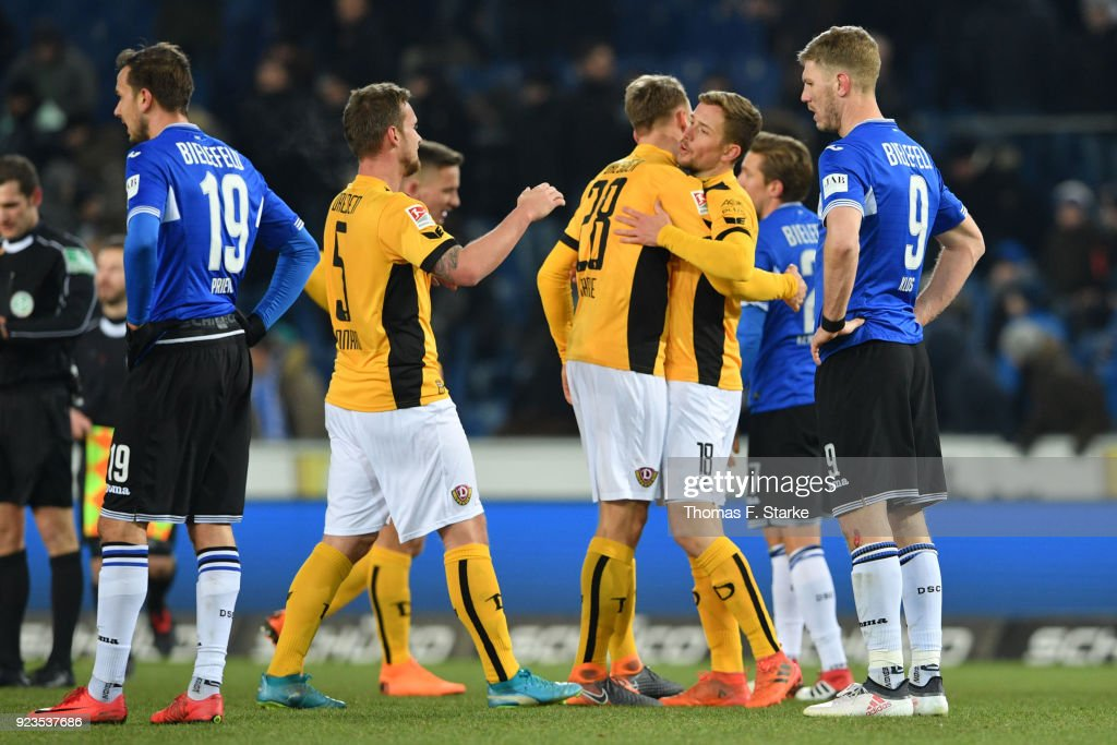 Manuel Prietl (L) and Fabian Klos (R) of Bielefeld look dejected while players of Dresden celebrate after the Second Bundesliga match between DSC Arminia Bielefeld and SG Dynamo Dresden at Schueco Arena on February 23, 2018 in Bielefeld, Germany.