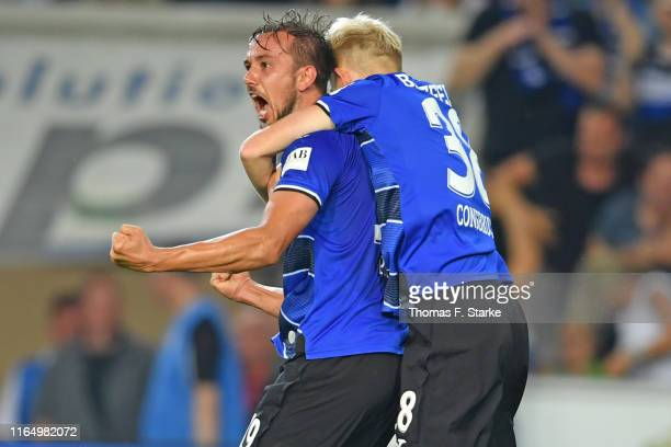 Manuel Prietl and Jomaine Consbruch of Bielefeld celebrate during the Second Bundesliga match between DSC Arminia Bielefeld and FC St Pauli at...