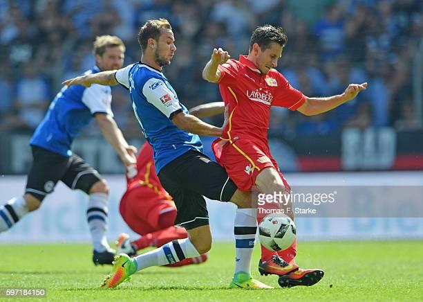 Manuel Prietl of Bielefeld tackles Steven Skrzybski of Berlin during the Second Bundesliga match between DSC Arminia Bielefeld and 1 FC Union Berlin...
