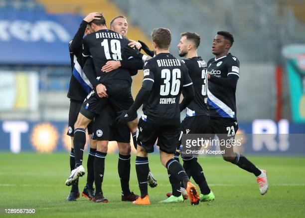 Manuel Prietl of DSC Arminia Bielefeld celebrates with teammate Joakim Nilsson after scoring his team's first goal during the Bundesliga match...