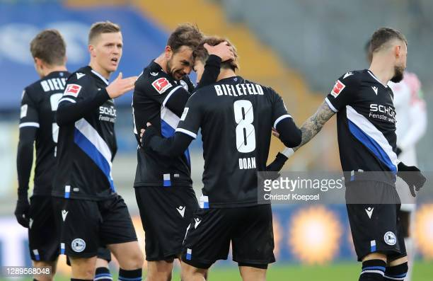 Manuel Prietl of DSC Arminia Bielefeld celebrates with teammate Ritsu Doan after scoring his team's first goal during the Bundesliga match between...