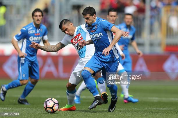 Manuel Pucciarelli of Empoli Fc battles for the ball with Loureiro Allan of SSC Napoli during the Serie A match between Empoli FC and SSC Napoli at...