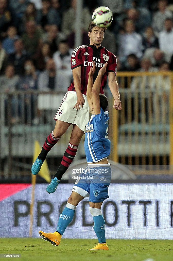 Manuel Pucciarelli of Empoli Fc battles for the ball with Mattia De Ciglio of AC Milan during the Serie A match between Empoli FC and AC Milan at Stadio Carlo Castellani on September 23, 2014 in Empoli, Italy.