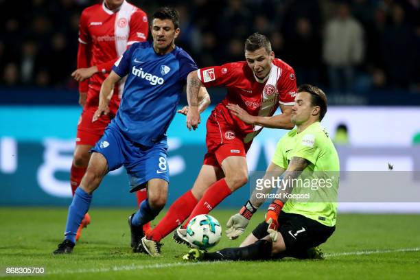 Manuel Riemann of Bochum saves the ball againsat Marcel Sobottka of Duesseldorf during the Second Bundesliga match between VfL Bochum 1848 and...