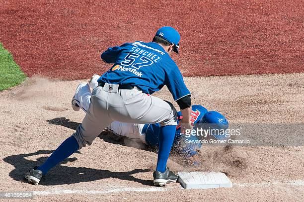Manuel Rodriguez of Charros de Jalisco slides in the first base during the game against Yaquis of Obregon in the first game of semifinals of liga del...