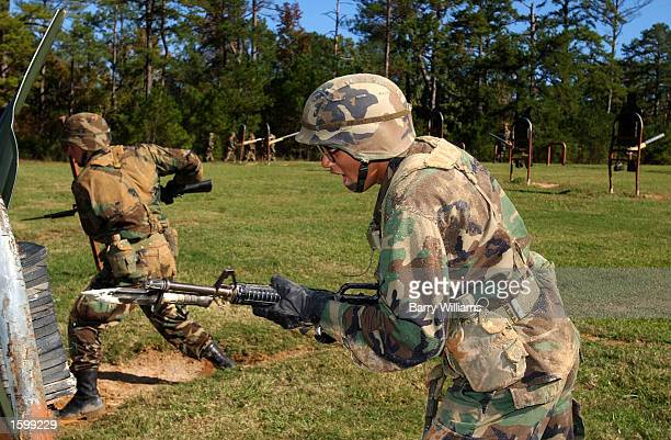 Manuel Rodriquez of New York City strikes a target with a bayonet as part of US Army basic training November 7 2002 in Fort Benning Georgia Over...