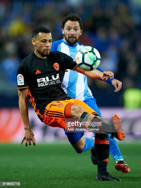 Manuel Rolando Iturra of Malaga CF duels for the ball with Francis Coquelin of Valencia CF during the La Liga match between Malaga and Valencia at...