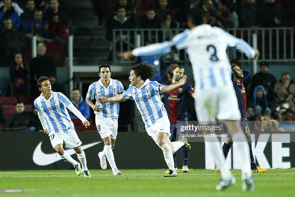 Manuel Ronaldo Iturra (3dL) of Malaga CF celebrates scoring his first goal with teammates Diego Buonanotte (L), Javier Pedro Saviola (2ndL) and behind them Javier Alejandro Mascherano (L) of FC Barcelona reacts defeated with his teammate Thiago Alcantara (R) during the Copa del Rey Quarter Final match between Barcelona FC and Malaga CF at Camp Nou on January 16, 2013 in Barcelona, Spain.