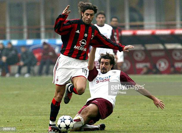 Manuel Rui Costa of Milan is tackled by Giacomo Tedesco of Reggina during the Serie A match between AC Milan and Reggina at the San Siro Stadium on...