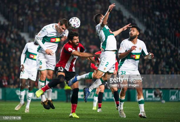 Manuel Sanchez of Elche competes for the ball with Raul Garcia of Athletic Club during the Copa del Rey round of 32 match between Elche CF and...