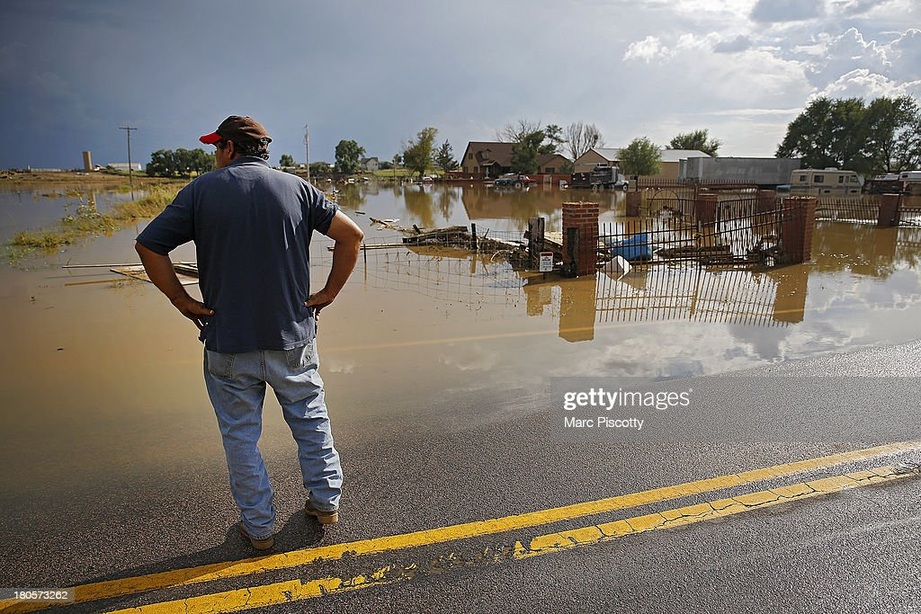 Manuel Sanchez takes in the view of his flooded home and property on September 14, 2013 in La Salle, Colorado. The Sanchez family has lived there for 11 years and said they've never seen anything even close to this level of flooding in the area. Heavy rains for the better part of week fueled widespread flooding in numerous Colorado towns. The historic flooding forced thousands to evacuate the area and more rain is predicted through the weekend.