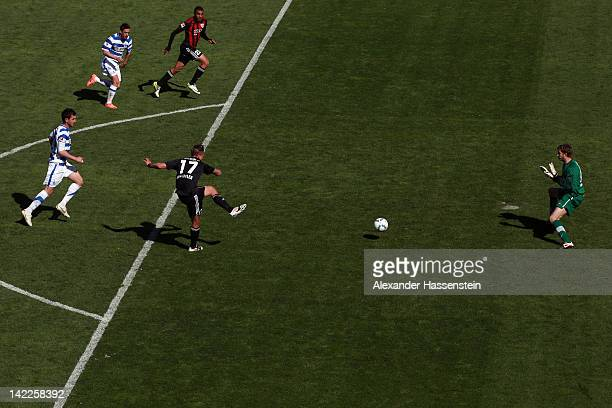 Manuel Schaeffler of Ingolstadt scores the first team goal against Felix Wiedwald keeper of Duisburg during the Second Bundesliga match between FC...