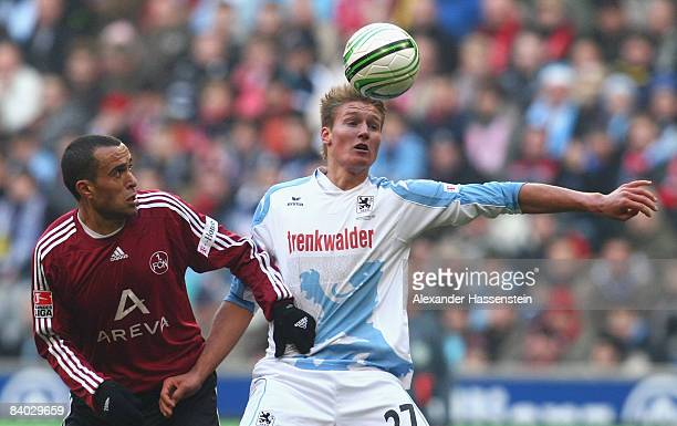 Manuel Schaeffler of Muenchen battles for the ball with Jaouhar Mnari of Nuernberg during the Second Bundesliga match between TSV 1860 Muenchen and...