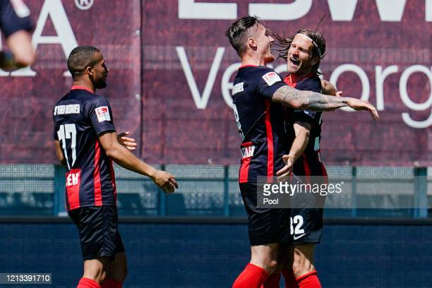 Manuel Schaeffler of SV Wehen Wiesbaden celebrates with teammate Stefan Aigner after scoring their side's first goal during the Second Bundesliga...