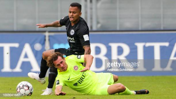 Manuel Schaeffler of SV Wehen Wiesbaden challenges Simon Falette of Eintracht Frankfurt during the Pre Season Friendly Match between SV Wehen...