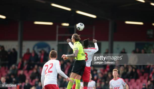 Manuel Schaeffler of Wiesbaden and Bernard Kyere of Cologne jump for a header during the 3 Liga match between SC Fortuna Koeln and SV Wehen Wiesbaden...