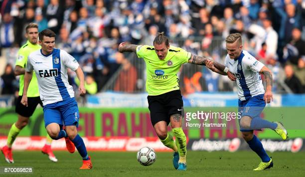 Manuel Schaeffler of Wiesbaden vies with Bjoern Rother and Nils Butzen of Magdeburg during the 3 Liga match between 1 FC Magdeburg and SV Wehen...